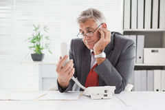 Smiling businessman put on hold Royalty Free Stock Image