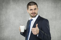 Smiling businessman recommend this coffee Royalty Free Stock Images