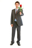 Smiling businessman with red rose Royalty Free Stock Photo