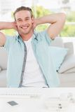 Smiling businessman relaxing with hands behind head Royalty Free Stock Photos