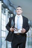 Smiling businessman runs towards camera Royalty Free Stock Photos