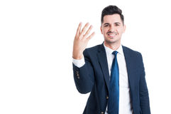 Smiling businessman or sales man showing number four Stock Photos