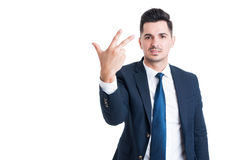 Smiling businessman or sales man showing number three Royalty Free Stock Photo