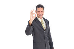 Smiling businessman saying ok Royalty Free Stock Images