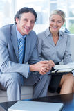 Smiling businessman and secretary looking at diary Royalty Free Stock Images