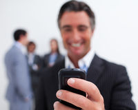 Smiling businessman sending a text Royalty Free Stock Image