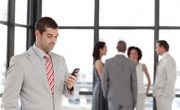 Smiling Businessman sending a text message Stock Photos