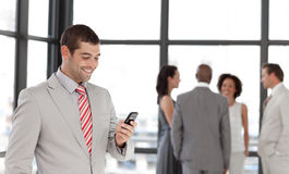 Smiling Businessman sending a text message Stock Images
