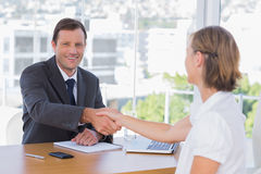 Smiling businessman shaking hand of a job applicant Royalty Free Stock Photos
