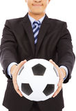 Smiling businessman show a soccer Royalty Free Stock Photo