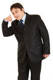 Smiling businessman showing contact me gesture Stock Image