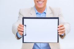 Smiling businessman showing his records Stock Images