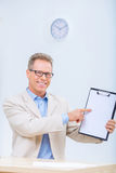 Smiling businessman showing his records Stock Photography