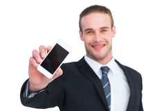 Smiling businessman showing his smartphone screen Royalty Free Stock Photography