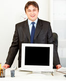 Smiling businessman showing monitors blank screen Royalty Free Stock Photo
