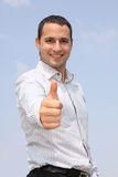 Smiling businessman showing ok Stock Photo