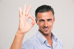 Smiling businessman showing ok sign Royalty Free Stock Images