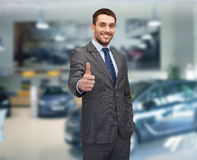 Smiling businessman showing thumbs up royalty free stock photo