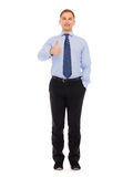 Smiling businessman showing thumbs up Stock Image