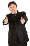 Smiling businessman showing thumbs up gesture Royalty Free Stock Photos