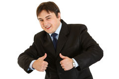 Smiling businessman showing  thumbs up gesture Stock Image