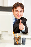 Smiling businessman showing thumbs up gesture Stock Photography