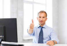 Smiling businessman showing thumbs up. Picture of smiling businessman showing thumbs up royalty free stock photo