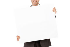Smiling businessman showing white paper Stock Photos