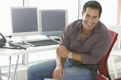 Smiling Businessman Sitting On Office Chair Stock Photos