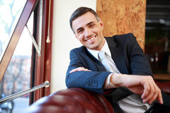 Smiling businessman sitting at the sofa Royalty Free Stock Photography