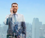 Smiling businessman with smartphone in city Royalty Free Stock Photography
