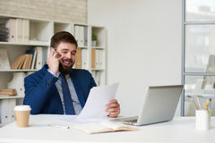 Smiling Businessman Speaking by Phone in office Stock Photo