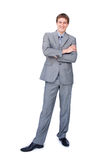 Smiling businessman standing with folded arms. Isolated on a white background Royalty Free Stock Image