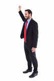 Smiling businessman standing with hand raised Stock Photography