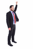 Smiling businessman standing with hand raised Royalty Free Stock Photography