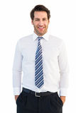 Smiling businessman standing with hands in pockets Stock Photo