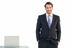 Smiling businessman standing with hands in pockets Royalty Free Stock Photos
