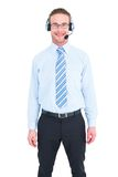 Smiling businessman standing with headset Stock Photo