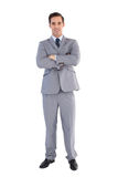 Smiling businessman standing with his arms crossed Stock Photography