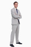 Smiling businessman standing with his arms folded Royalty Free Stock Photography