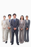 Smiling businessman standing with his team Royalty Free Stock Photography
