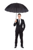 Smiling businessman standing with open umbrella Royalty Free Stock Images