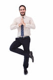 Smiling businessman standing in tree pose Royalty Free Stock Image