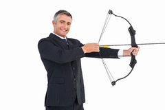 Smiling businessman stretching a bow Royalty Free Stock Image