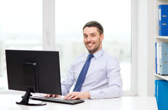 Smiling businessman or student with computer. Office, business, education, technology and internet concept - smiling businessman or student with computer Royalty Free Stock Image