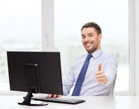 Smiling businessman or student with computer stock image