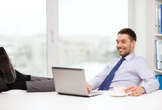 Smiling businessman or student with laptop Stock Photography