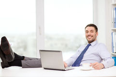 Smiling businessman or student with laptop Stock Photos