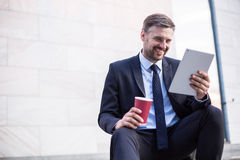 Smiling businessman after successful workday. Photo of smiling businessman relaxing after successful workday Royalty Free Stock Photo