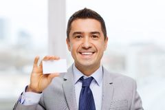 Smiling businessman in suit showing visiting card Stock Photos